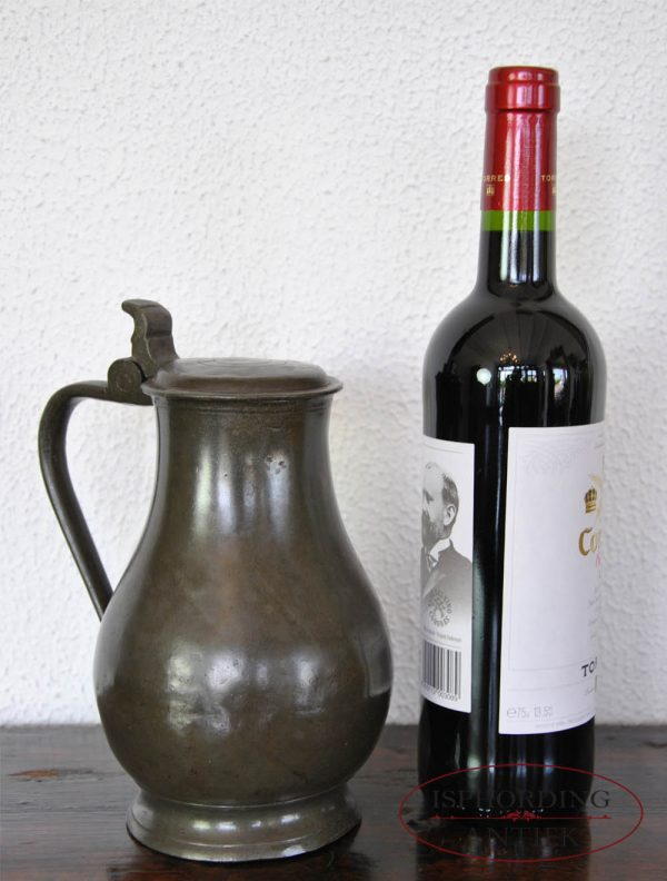 Pewter Dutch flagon with bottle