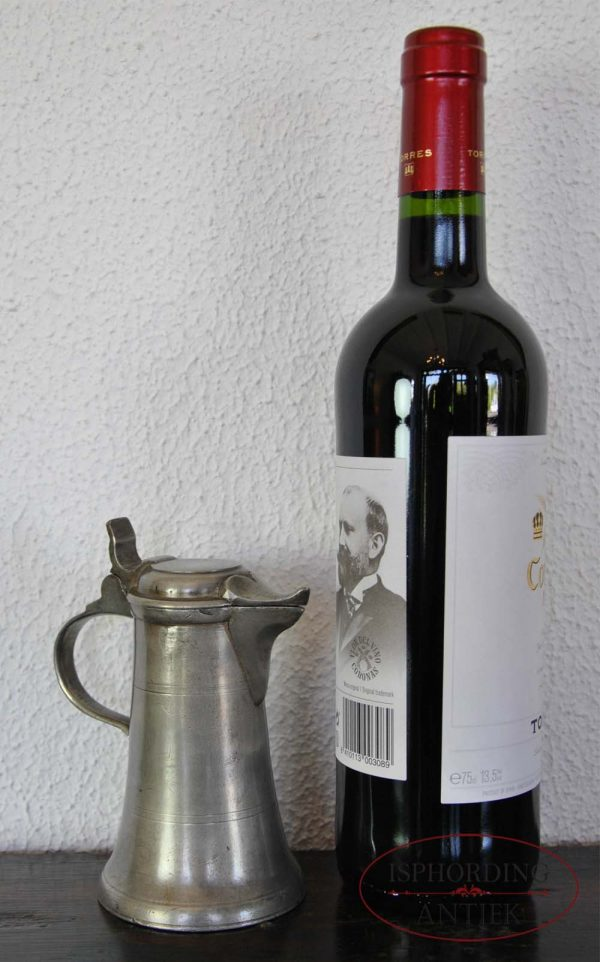 Small pewter Austrian flagon with bottle