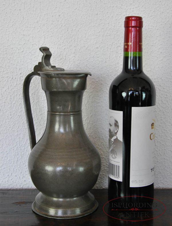 Tinnen Zwitserse kan met fles
