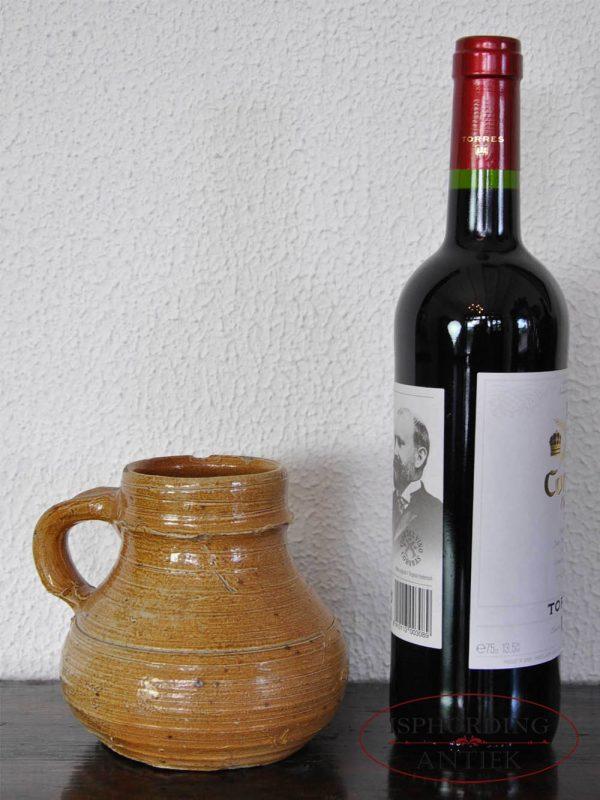 Stoneware jug Raeren with bottle