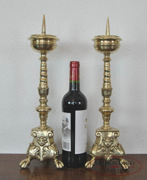 Pricket candlesticks with bottle